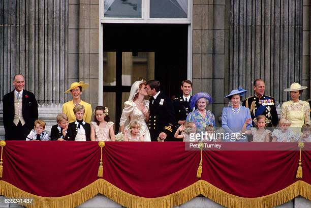 The newlywedded couple Prince Andrew and Sarah Ferguson and other members of the royal family greet the public at Buckingham Palace following the...
