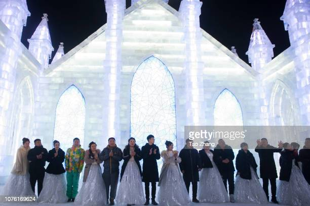 The newlyweds hold a ceremony at the Harbin ice and snow world to celebrate the new year at Harbin Sun Island park on December 31 2018 in Harbin...