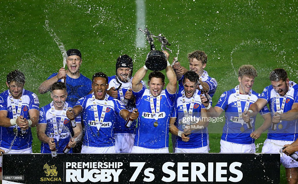 The Newport Gwent Dragons' players celebrate as Geraint Rhys Jones of Newport Gwent Dragons lifts the trophy during the Singha Premiership Rugby 7s Series Final at Twickenham Stoop on August 28, 2015 in London, England.