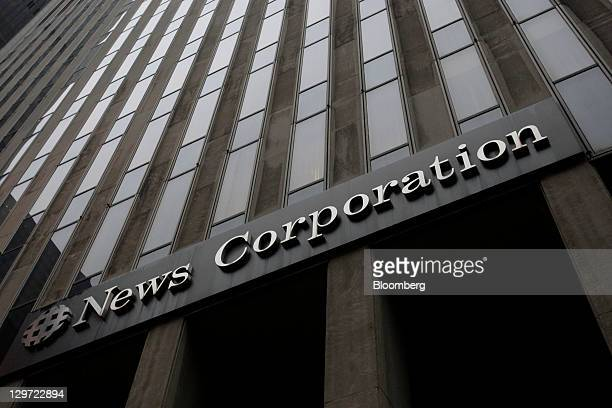 The News Corp logo is displayed on the company's headquarters in New York US on Wednesday Oct 19 2011 News Corp investors seeking to curb Chairman...