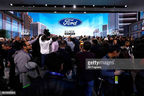 The news media swarm the stage to get a closer look at the 2019 Ford Ranger truck Ford Edge ST and Ford Mustang Bullitt at their debuts at the 2018...