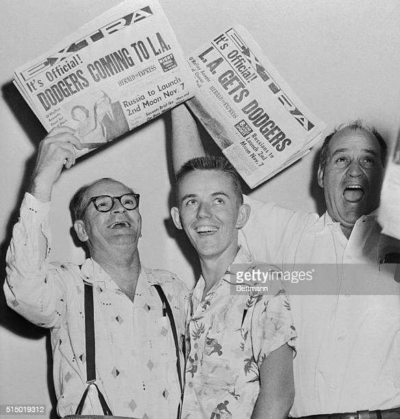 The News that Brooklyn Dodgers will become the Los Angeles Dodgers, here happy fans whoop up for joy. From left, Roy Johnson, Bill Redden and Ben...