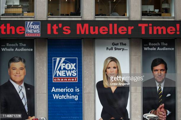 The news ticker at Fox News headquarters scrolls headlines before Special Counsel Robert Mueller makes a statement about the Russia investigation May...