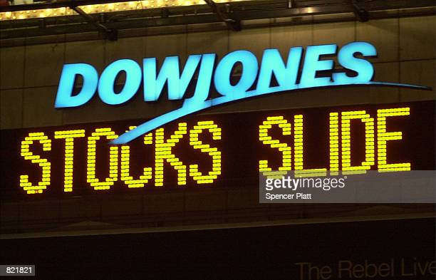 The news ticker in New York's Times Square comments March 20 2001 on the state of the economy The Dow Jones industrials ended down 23835 at 972076...