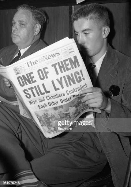 The newspaper headline in the hands of John Slater of Ablington Virginia tells the story of today's long awaited facetoface meeting of Alger Hiss and...