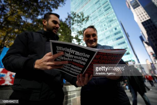 The newspaper of misinformation news stand is inspected by people in Manhattan, New York, United States on October 30, 2018. The Columbia Journalism...