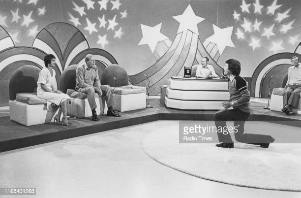 The newsreader team Jan Leeming Peter Woods and John Craven watched by presenter Graeme Green and comedian Kenneth Williams on the BBC quiz show...