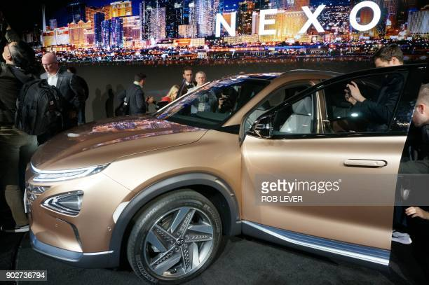 The Nexo a hydrogen fuelcell powered vehicle is presented at the International Consumer Electronics Show in Las Vegas on January 8 2018 Hyundai on...
