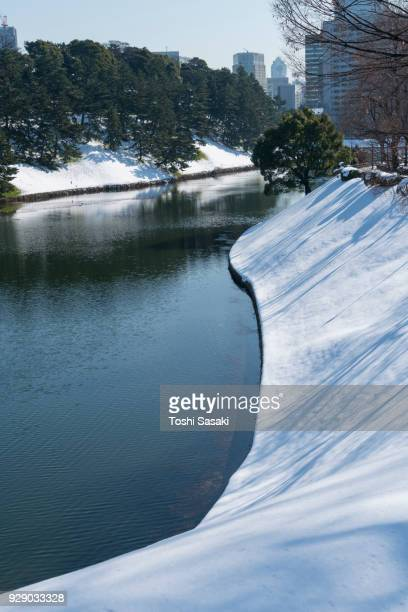 The next morning of winter snowstorm at Chiyoda-ku Tokyo Japan – January. 23 2018. Snowy Imperial Palace Moat along the Uchibori-dori.