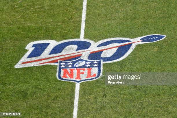 The NFL 100 year anniversary logo is seen on the field before the AFC Championship Game between the Kansas City Chiefs and the Tennessee Titans at...