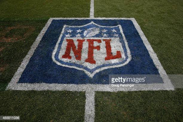 The NFL logo is displayed on the turf as the Denver Broncos defeated the Kansas City Chiefs 2417 at Sports Authority Field at Mile High on September...