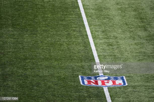 The NFL logo on the turf at Gillette Stadium prior to the start of the game between the Miami Dolphins and New England Patriots on September 13 2020...