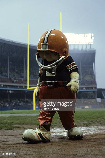 The NFL mascot for the Cleveland Browns named Huddles entertains the fans on the field during a game on October 28 1984 against the New Orleans...