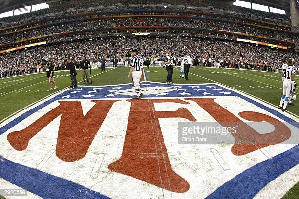 The NFL symbol painted on the 50 yard line prior to the start of Super Bowl XXXVIII between the New England Patriots and the Carolina Panthers at...