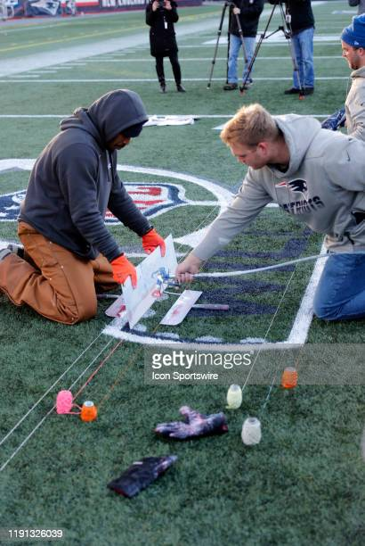 The NFL Wild Card logo is spray painted onto the field during press conferences in advance of the AFC Wild Card Game between the New England Patriots...
