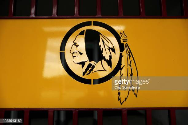 The NFL's Washington Redskin's logo is stamped in a steel gate at FedEx Field July 13 2020 in Landover Maryland The team announced Monday that owner...