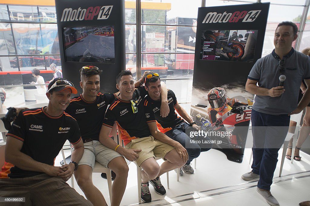 The NGM Mobile Forward Racing riders pose during the event 'Milestone presents the official MotoGP 2014 videogame' during the MotoGp of Catalunya- Previews at Circuit de Catalunya on June 12, 2014 in Montmelo, Spain.