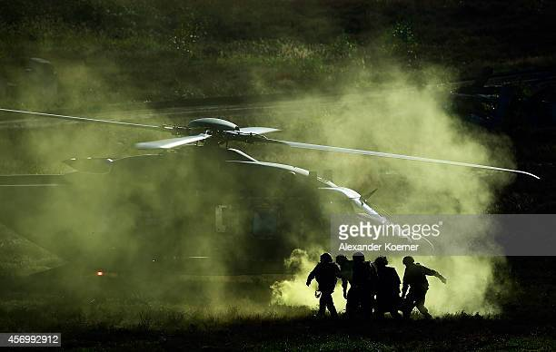 The NH90 Helicopter is pictured during an evacuation of an injured soldier during an exercise in Munster prior the arrival of German Defense Minister...