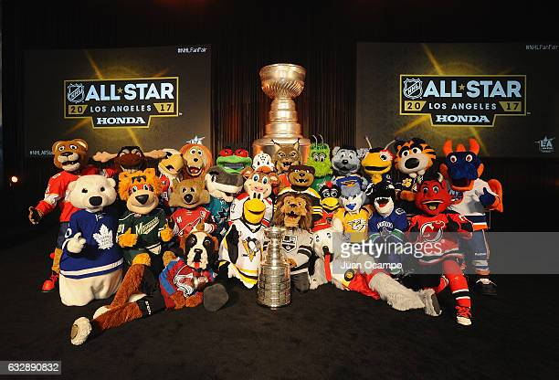 The NHL mascots pose with the Stanley Cup before the Mascot Showdown at the Fan Fair as part of the 2017 NHL AllStar Weekend at the Los Angeles...