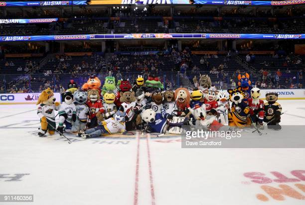 The NHL team mascots pose for a group photo at center ice during the PreGame Mascot Showdown at Amalie Arena on January 28 2018 in Tampa Florida