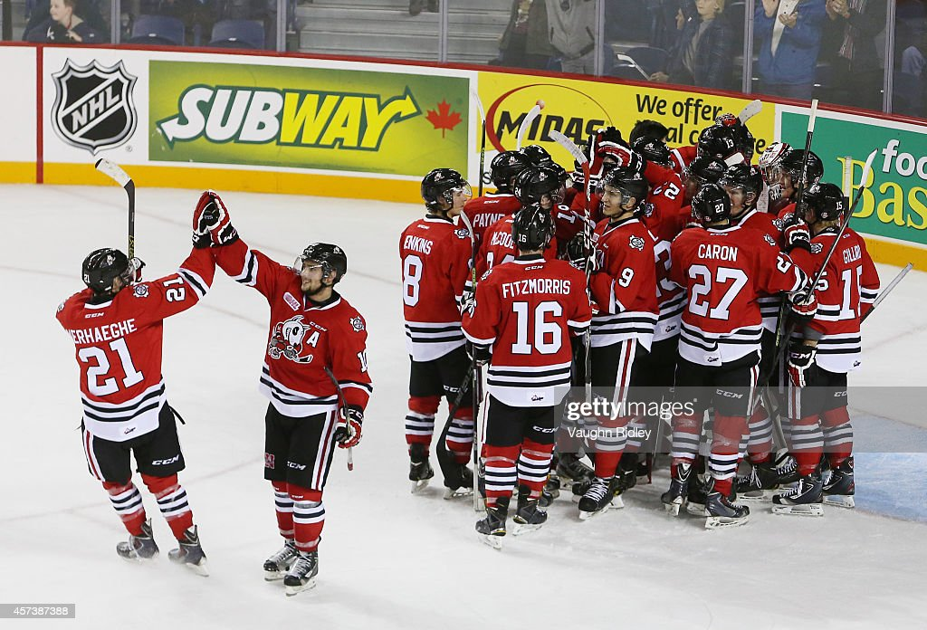The Niagara Ice Dogs celebrate winning 7-4 in an OHL game against the Belleville Bulls at the Meridian Centre on October 16, 2014 in St Catharines, Ontario, Canada.