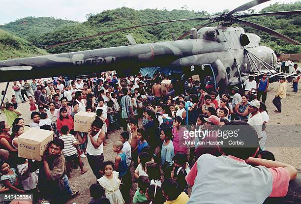 The Nicaraguan army distributes food aid in a village destroyed by Hurricane Mitch.