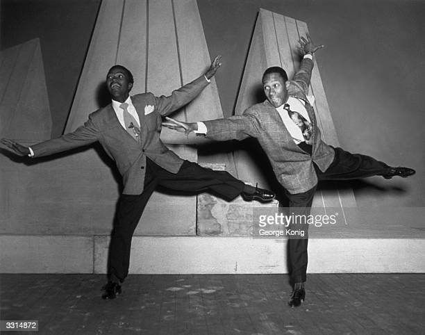 The Nicholas Brothers display perfect timing during a dance show