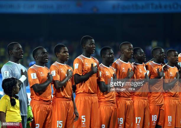 The Niger team sing their national anthem during the FIFA U17 World Cup India 2017 group D match between Korea Republic and Niger at Jawaharlal Nehru...