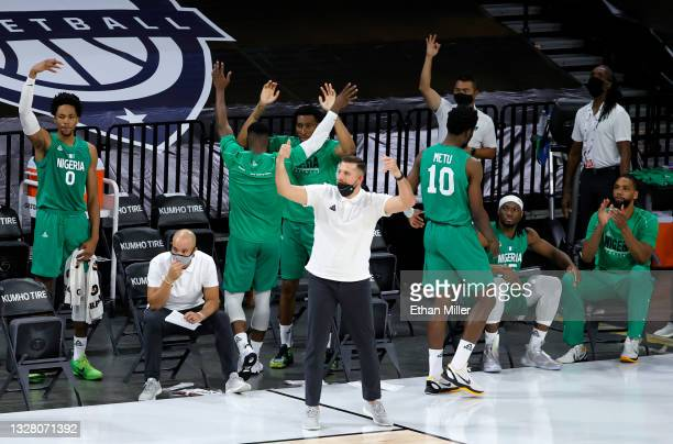 The Nigeria bench reacts after Ike Iroegbu of Nigeria hit a 3-pointer against the United States in the fourth quarter of an exhibition game at...