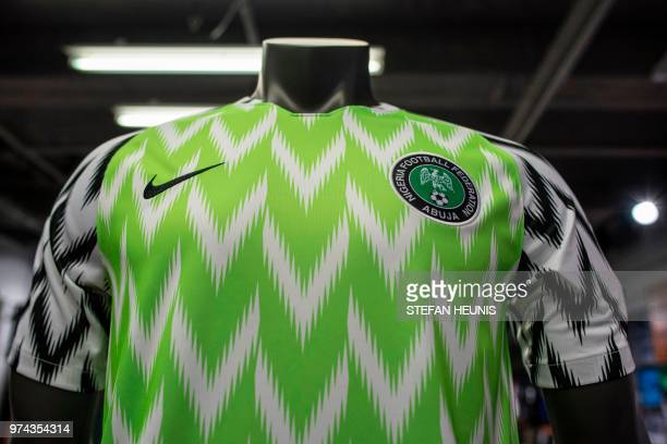 The Nigeria Super Eagles jersey for the 2018 World Cup in Russia is seen in a Nike store in Lagos on June 4 2018 The Nigeria Super Eagles jersey for...