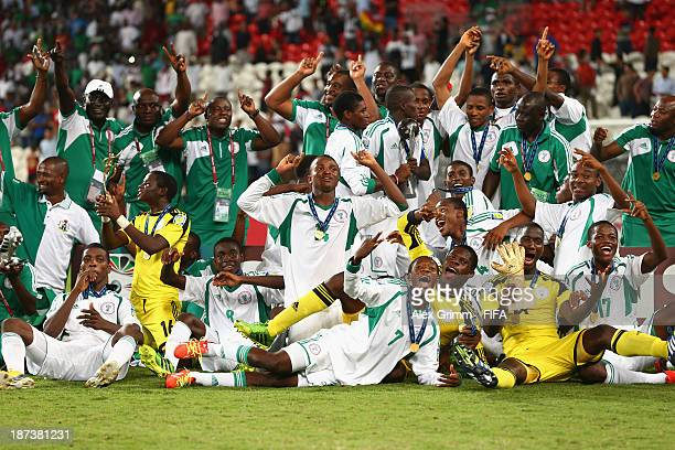 The Nigeria team celebrate their victory after the FIFA World Cup UAE 2013 Final between Nigeria and Mexico at Mohamed Bin Zayed Stadium on November...