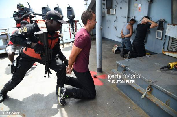 The Nigerian Navy Special forces pretend to arrest pirates on F375 Germinal French Frigate in a stage managed operations during the five-day joint...