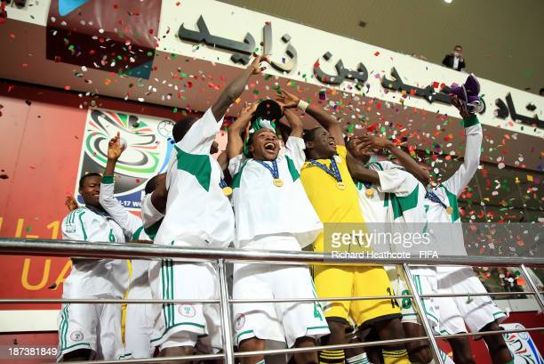 The Nigerian team lift the trophy after beating Mexico 30 in the FIFA U17 World Cup UAE 2013 Final between Nigeria and Mexico at the Mohamed Bin...