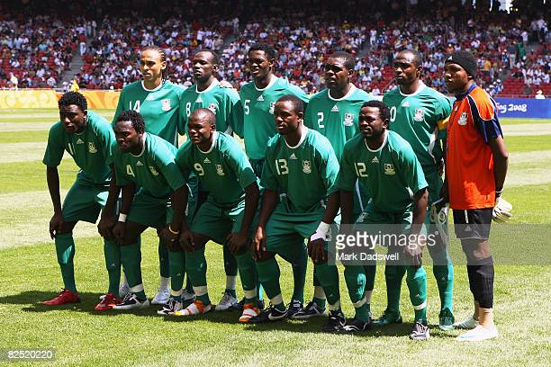 The Nigerian teams lines up prior to the Men's Gold Medal football match between Nigeria and Argentina at the National Stadium on Day 15 of the...