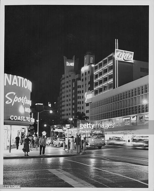 The night life at the busy junction of Lincoln Road and Collins Avenue, Miami Beach, Florida, circa 1920-1960.