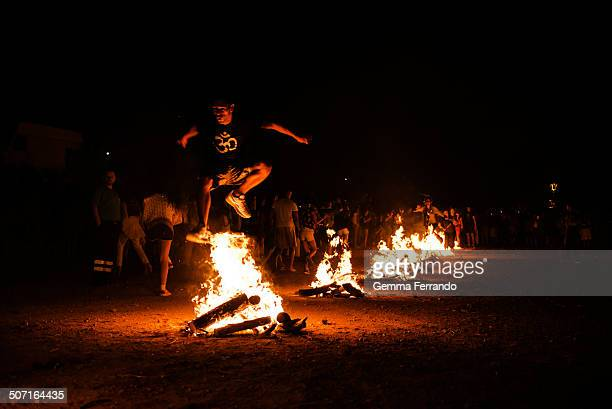 The Night of St John's Day in the village of San Joan de Labritja, in Ibiza, people lights nine fires in a row that people jump in order to celebrate...