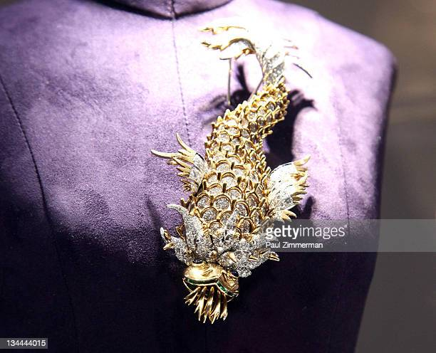 """The night of the Iguana brooch by Jean Schlumberger owned by Elizabeth Taylor and gift from Richard Burton on display at """"The Collection Of Elizabeth..."""