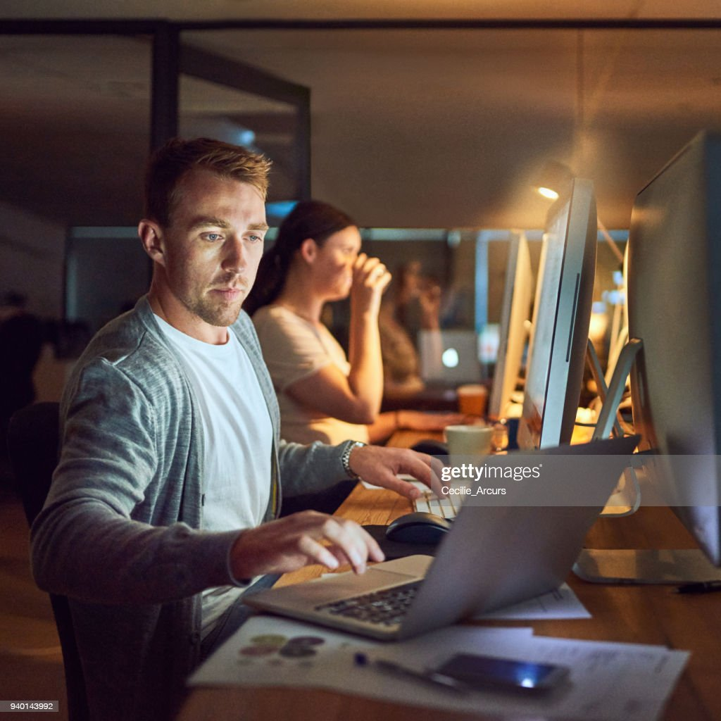 The night owls in networking mode : Stock Photo