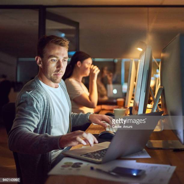 the night owls in networking mode - computer software stock pictures, royalty-free photos & images