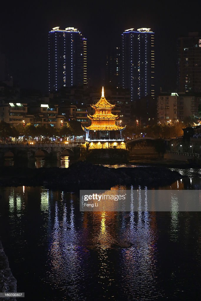 The night scene of an array of edifices and the Jiaxiulou Tower, the city's landmark ancient building for sightseeing, on January 27, 2013 in Guiyang of Guizhou Province, China.