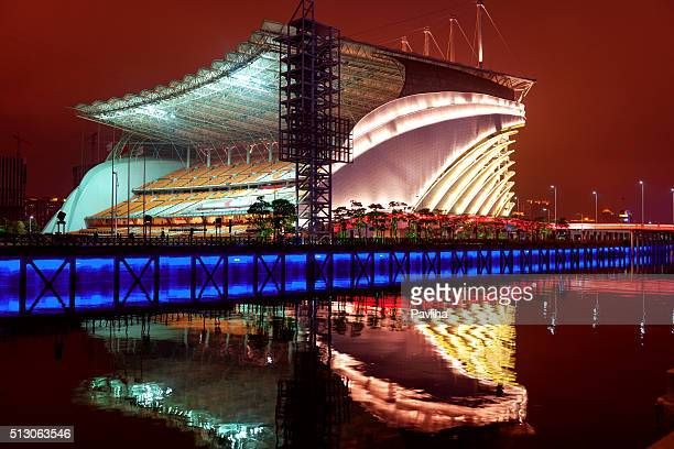 the night scenic  stadium in guangzhou,china - pavliha stock photos and pictures