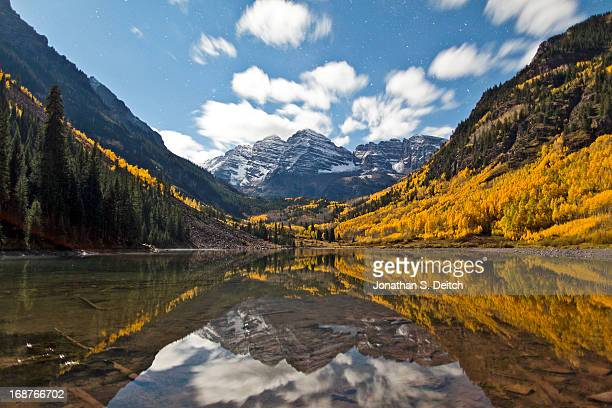 the night sky in fall at maroon bells. - maroon bells stock photos and pictures