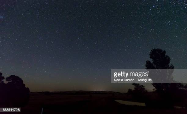 The night sky with a wind farm at the country side in Victoria, Australia