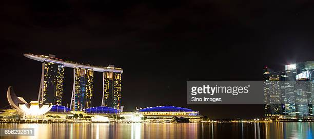 the night view of singapore marina bay  - marina bay sands stock photos and pictures