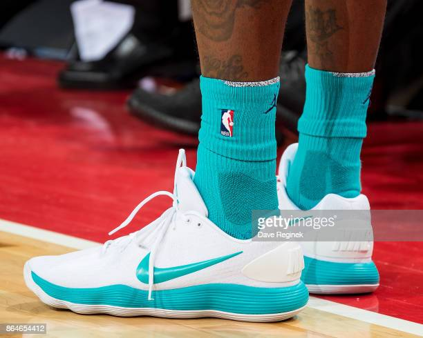 The Nike basketball shoes of Marvin Williams of the Charlotte Hornets during the Inaugural NBA game against the Detroit Pistons at the new Little...