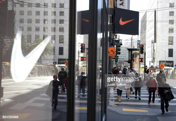 The Nike logo is displayed in a window at a Nike Store on September 26 2017 in San Francisco California Nike will report first quarter earnings today...