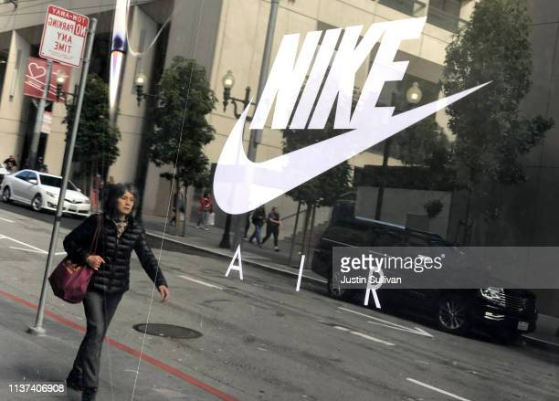 The Nike logo is displayed on a window at a Nike store on March 21 2019 in San Francisco California Nike will report third quarter earnings today...