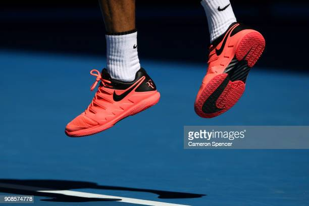 The Nike shoes of Roger Federer of Switzerland are seen as he serves in his fourth round match against Marton Fucsovics of Hungary on day eight of...