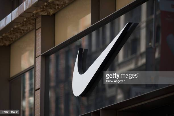 The Nike 'swoosh' logo is displayed on the outside of the Nike SoHo store June 15 2017 in New York City Nike announced plans on Thursday to cut about...
