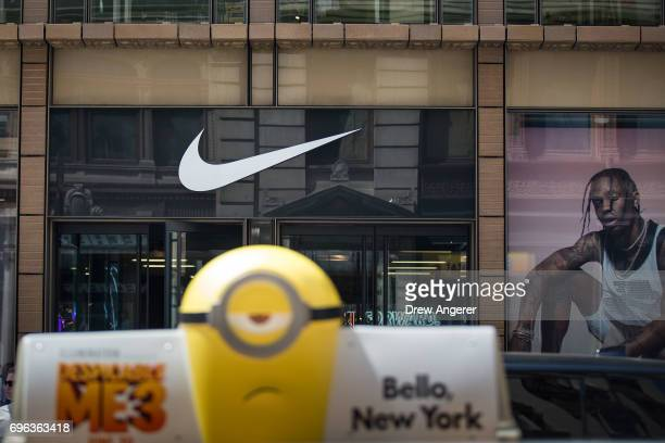 The Nike 'swoosh' logo is displayed on the outside of the Nike SoHo store, June 15, 2017 in New York City. Nike announced plans on Thursday to cut...